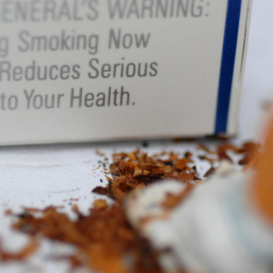Photo of surgeon general's warning and putting out cigarette